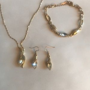 Gold necklace, bracelet and earrings